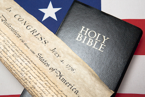 composite image of the American flag, Holy Bible, and the Declaration of Independence