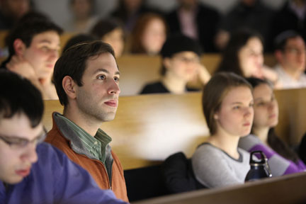 YU students listening in an auditorium