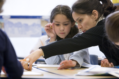 Teacher with a student in a classroom