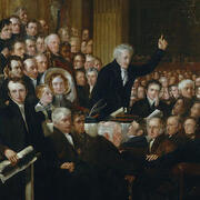 Painting of people sitting all together with one man standing and raising his hand