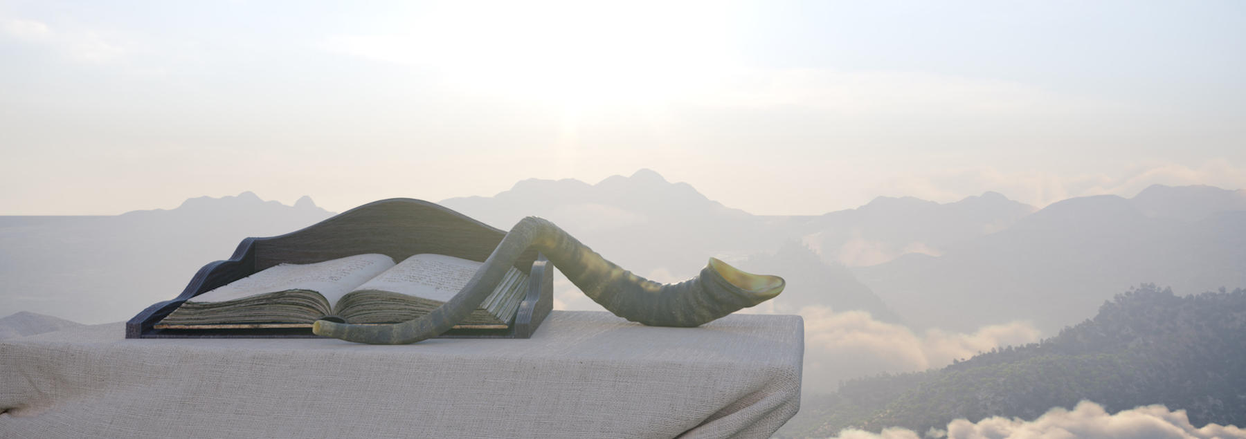 shofar and torah on an altar overlooking the mountains