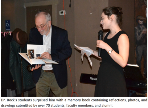 Dr. Rock receiving memory book