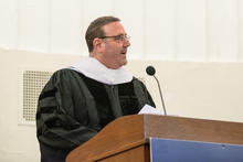 Dr. Alec Miller giving speech at graduation