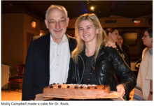 Dr. Rock and guest with cake