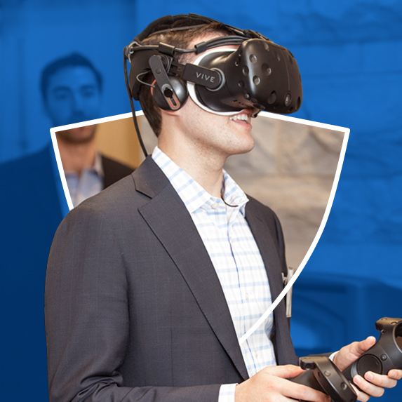 9313714cf326 student wearing vr headset and holding controllers